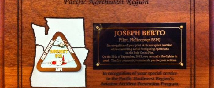 Helicopter pilot officially commended for extracting firefighter in water bucket