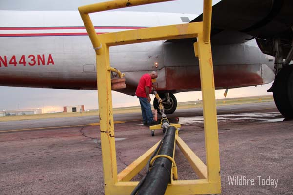 A P2V air tanker being reloaded at Rapid City