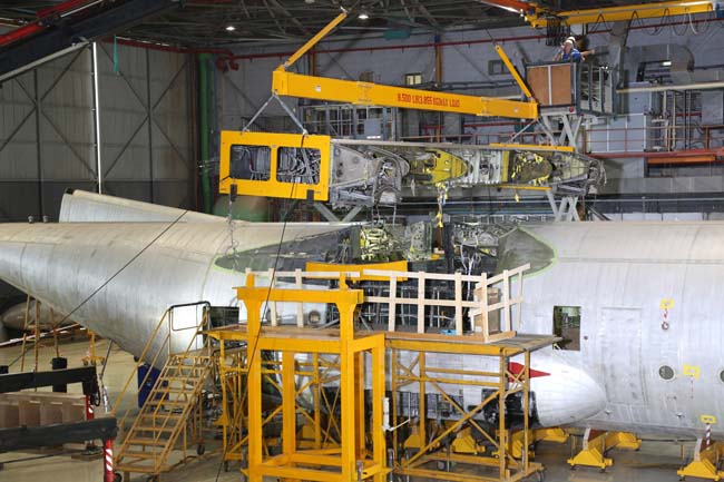 A C-130H of Israel Air Force receives a new wing box
