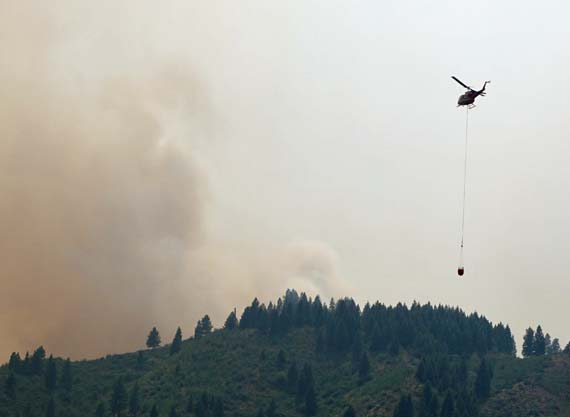 Helicopter with bucket on Whiskey Creek Fire,
