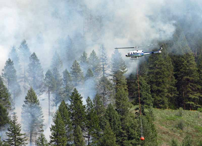 A helicopter prepares to drop water on the Hungry Hill Fire. InciWeb photo, May 8, 2015.