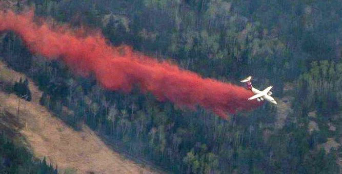 A BAe-146 air tanker dropping on a recent wildfire in Canada.