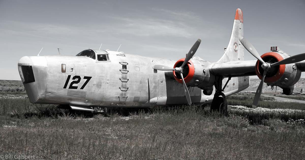 A passerby stops at the air tanker museum in Greybull