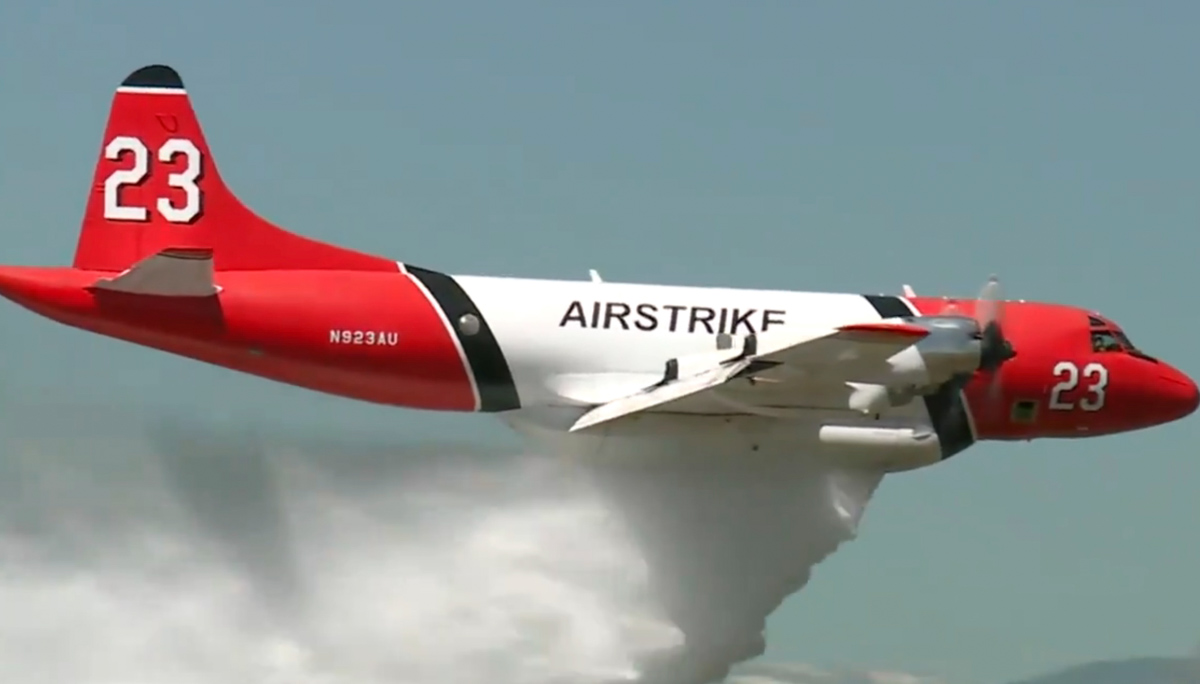 Tanker 23, a P3 Orion, making a demonstration drop at Northern Colorado Regional Airport June 28, 2019. Screengrab from
