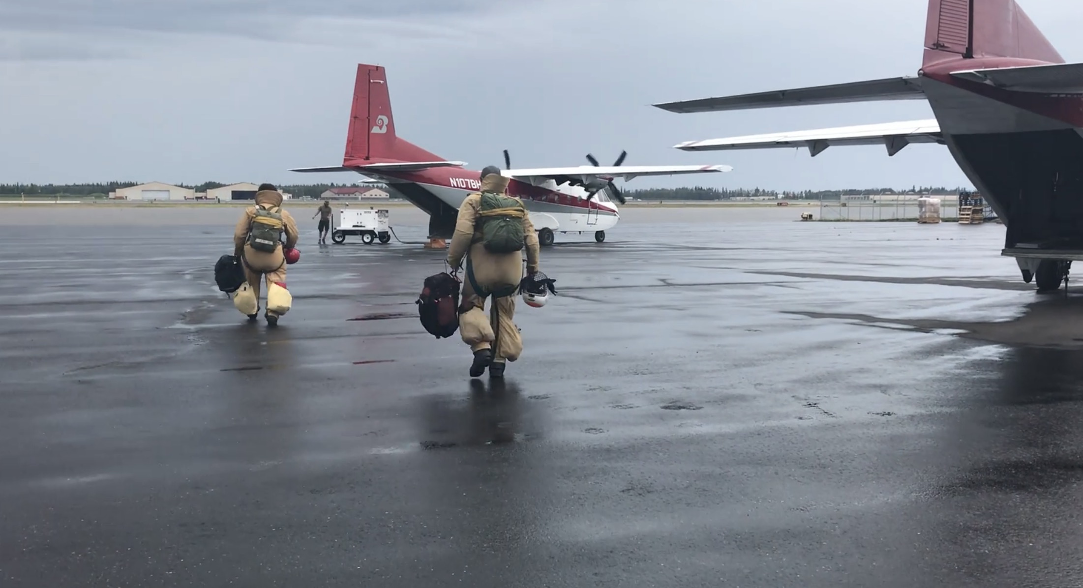 Smokejumpers board their aircraft