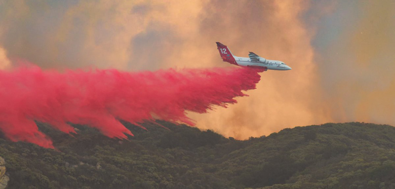 air tanker dropping Cave Fire Santa Barbara California