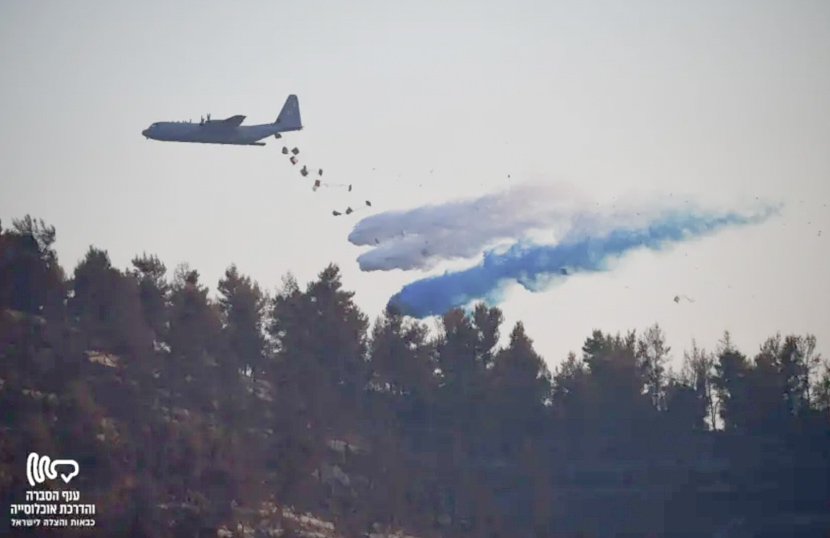 C-130 drops boxes of water on a wildfire