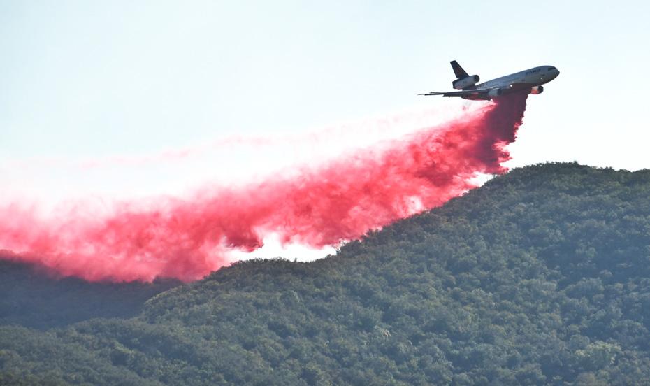 Tanker 910 dropping Alisal Fire
